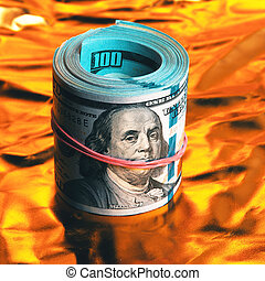 A roll of one hundred American dollars in close-up on a burning bright gold background