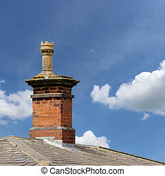 A Roof Top with Red Brick Chimney