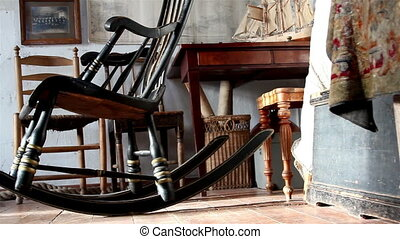 A room filled with things inside a rocking chair chairs boat...