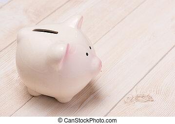 a, rosafarbene piggy bank, auf, hölzern, tisch.
