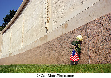Walls of the Missing - A rose and American flag in front of...