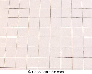 A rose tile wall outside the street