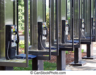 phone booth - a row of identical pay phone booths