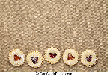 jam heart biscuits on burlap canvas