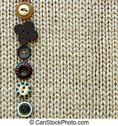 a row of natural colored vintage sewing buttons are lined up, framing tan tweed fabric square background