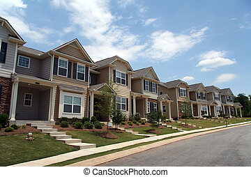 A row of new townhomes or condominiums - A row of new...