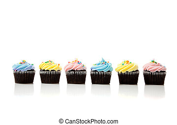 A row of pastel cupcakes on a white background