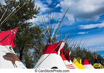 A row of plains indian teepees in alberta, North America.