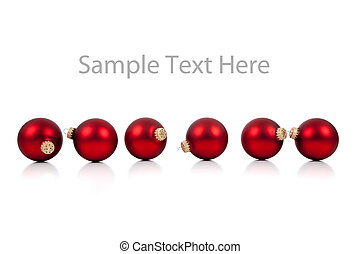 A row of red Christmas ornaments/baubles on white