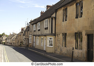 A row of stone cottages in a town in the Cotswolds, England
