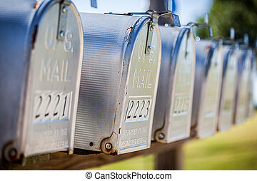 A row of United States mail boxes