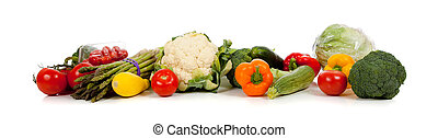 A row of vegetables on white - A row of vegetables including...