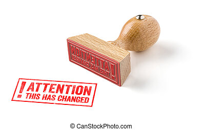 A rubber stamp on a white background - Attention this has...