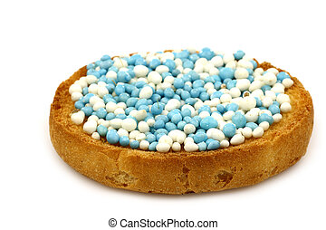 a rusk with anise seeds sprinkles - a rusk with blue and...