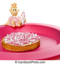 a rusk with white and pink mice, a dutch tradition