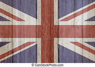A rustic old British flag on weathered wood