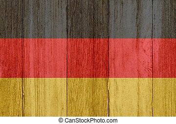 A rustic old German flag on weathered wood