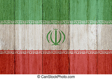 A rustic old Iranian flag on weathered wood