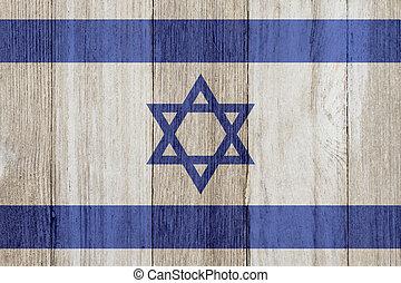 A rustic old Israel flag on weathered wood