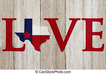 A rustic old Love Texas message, Texas map on weathered wood...