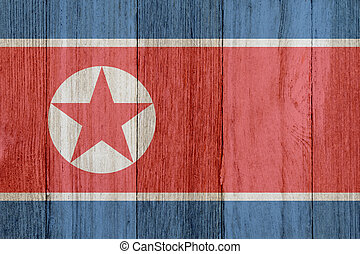 A rustic old North Korean flag on weathered wood