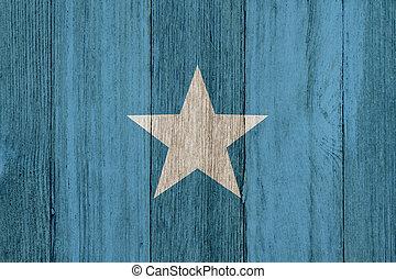 A rustic old Somalian flag on weathered wood