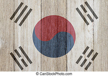 A rustic old South Korean flag on weathered wood