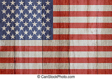 A rustic old USA flag on weathered wood