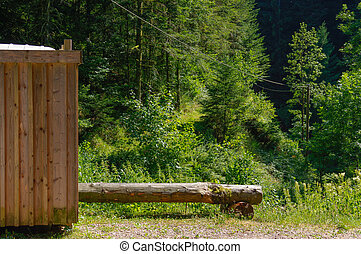 Rustic old wooden public toilet in the forest