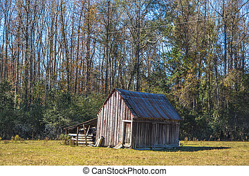 A rustic structure on a farm in the rural south