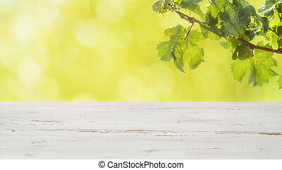 A rustic wooden table with grapevines
