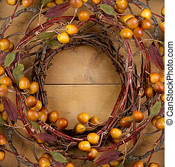 A rustic wreath on a wooden background