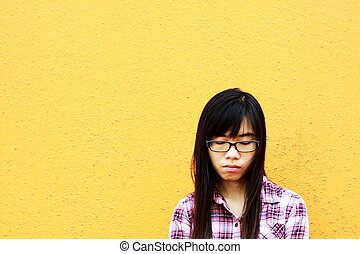 A sad Asian woman