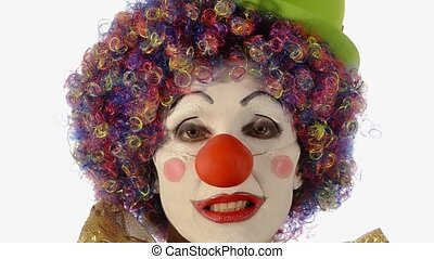 Female clown removing make up after performance. The sadness behind the laughter