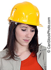 A sad female construction worker.