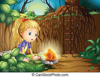 A sad girl making a campfire
