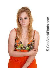 A sad looking teen girl.
