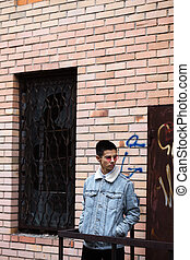 young man near an abandoned building
