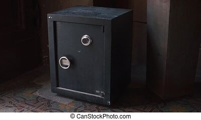 A safe with money of one million dollars is in a dark room.