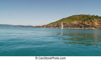 A sailboat across the ocean