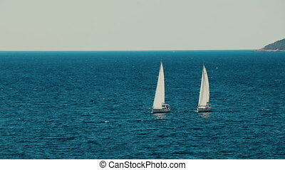 A sailboat on the horizon in the beautiful Adriatic sea