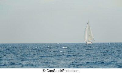 A sailboat on the horizon in the beautiful Caribbean ocean