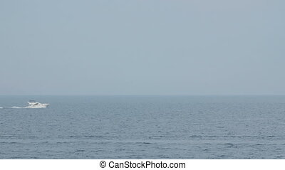 A sailboat on the horizon in the beautiful Mediterranean sea.