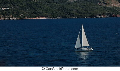 A sailboat, yacht on the horizon in the Adriatic sea