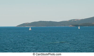 A sailboats on the horizon in the beautiful Adriatic sea