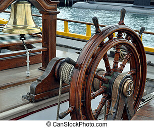 A Sailing Ship's Bell and Wheel - The Bell and Wheel of a...