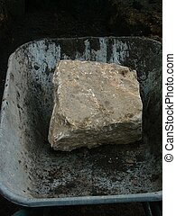 cornerstone - a sandstone as a cornerstone in a wheelbarrow