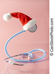 A santa claus hat with stethoscope on the pink background