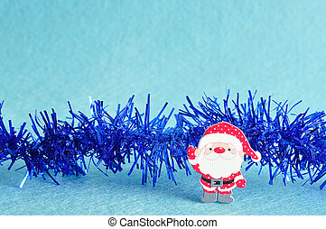 A santa with blue tinsel isolated on a blue background