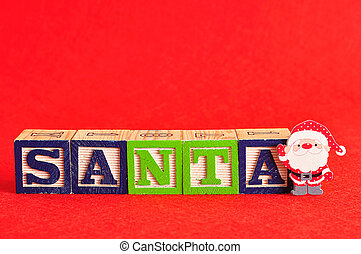 A santa with the word santa spelled with colorful alphabet blocks